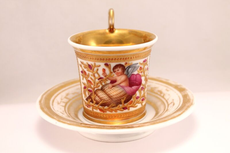 19th century Royal Vienna Style Cup and Saucer with Winged Cherub in Relief