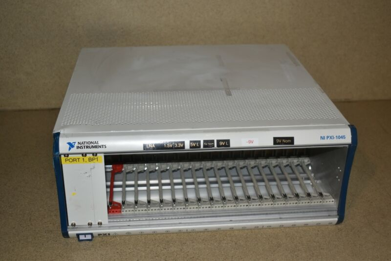 ^^ NATIONAL INSTRUMENTS NI PXI-1045 18 SLOT CHASSIS (YR78)