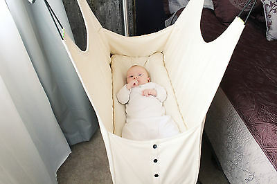 An Infant Relaxing Happily In A Hushamok Hammock
