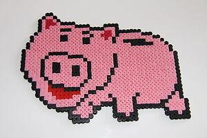 Pixel art perles a repasser cochon tirelire dans toy - Le cochon de toy story ...
