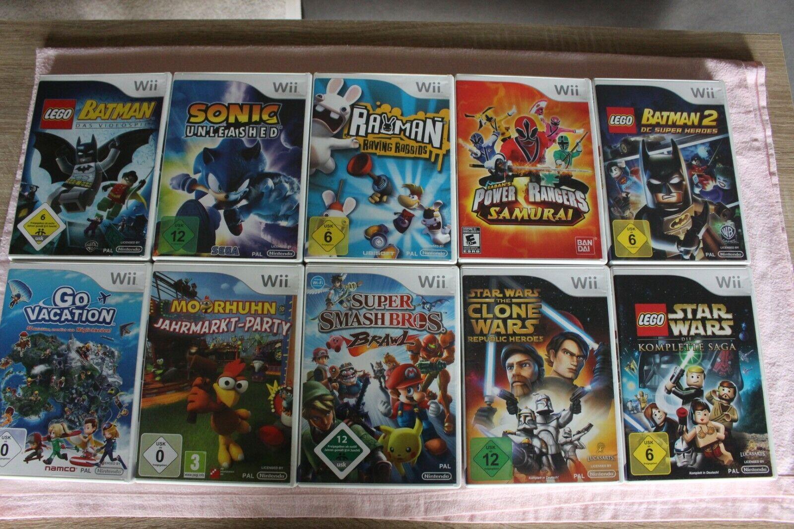 Nintendo Wii 10 Spiele und Wii Sports Zubehörpaket für Go Vacation