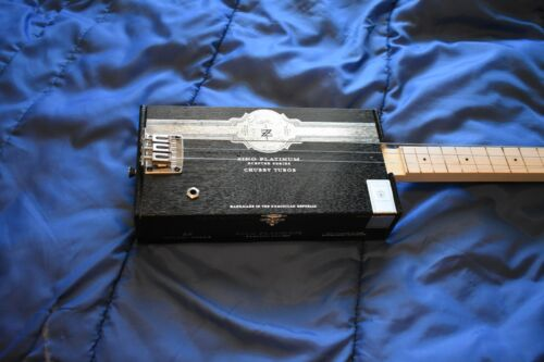 3 string Cigar Box Guitar package includes guitar cable, strap, slide and picks!