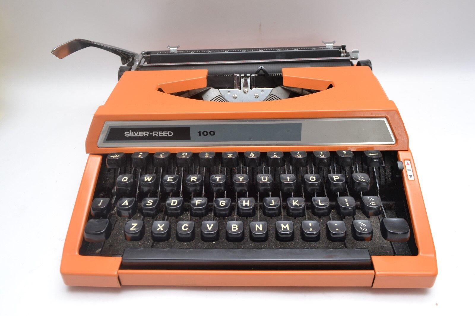 Fabulously Vibrant Mid Century Vintage Orange Silver Reed Typewriter and Case