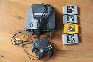 Nintendo 64 with 1 Controller and 4 game cartridges