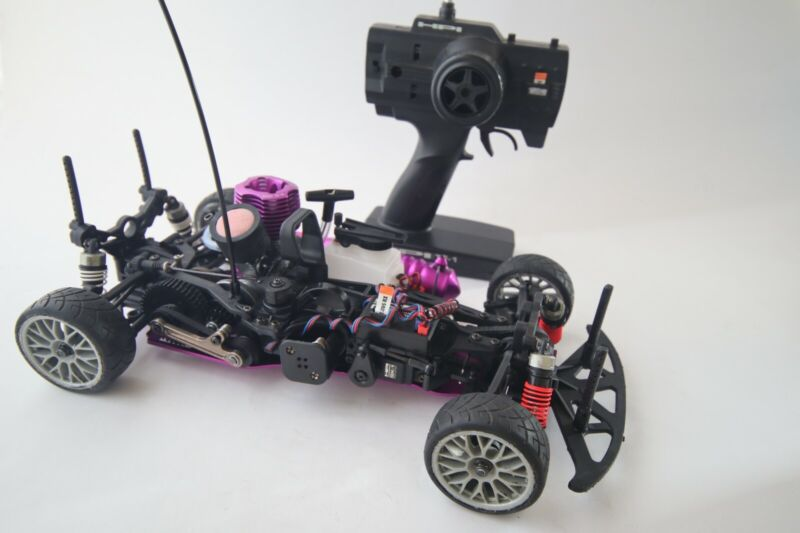 Vintage HPI RS4 Nitro with upgrades including 2 speed. Complete less body shell.