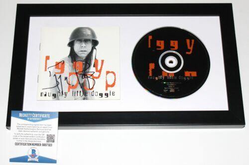 IGGY POP SIGNED FRAMED 'NAUGHTY LITTLE DOGGIE' CD COVER BOOKLET BECKETT COA BAS