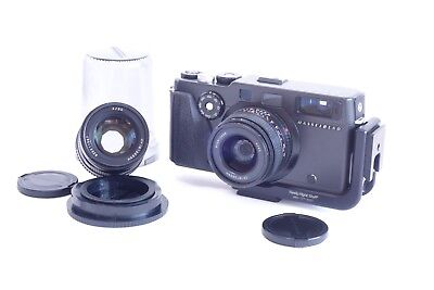 Hasselblad XPan with 45 and 90mm lenses, two filters, and custom grip