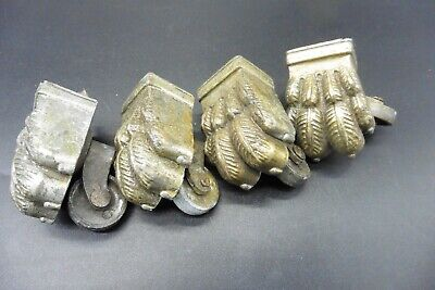Four antique lion's paw casters