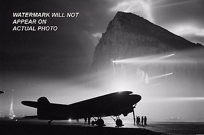 A Douglas Dakota of BOAC at Gibraltar, silhouetted by searchlights on the Rock