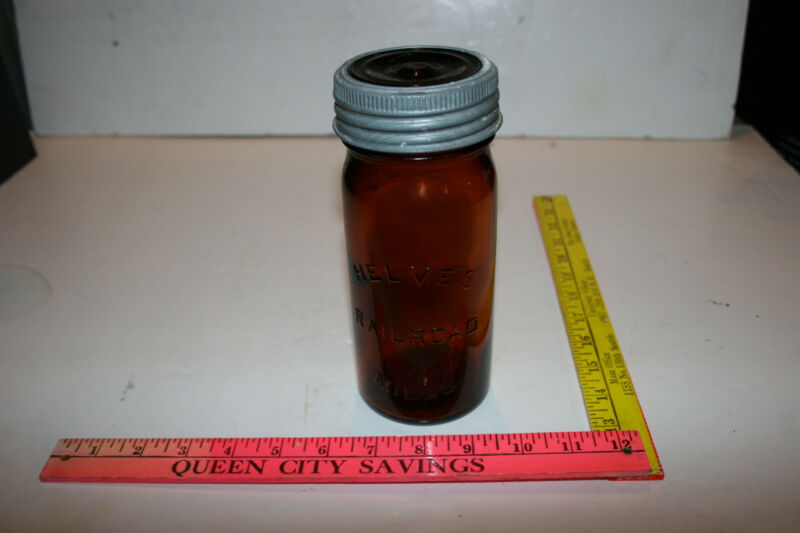 nice rare amber brown Helmes Railroad Mills snuff jar with ring and lid 1920s