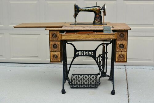 Singer Treadle Sewing Machine, model 66, 1910, with oak 7 drawer cabinet, manual