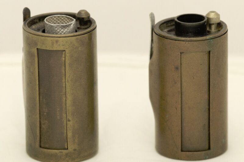 2 leica metal film canisters