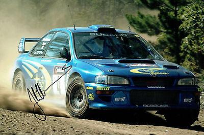Juha KANKKUNEN RALLY DRIVER SIGNED AUTOGRAPH 12x8 Subaru Photo AFTAL COA