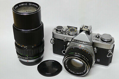 Olympus OM-1 mit Olympus 1,8 / 50 + 75-150 mm Objektiv analoge SLR Kamera