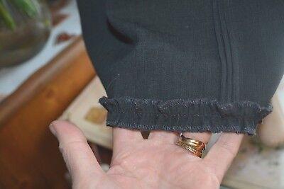 Robe dior 4 ans noire doublee 45% de laine  doublure rouge tres tres chic