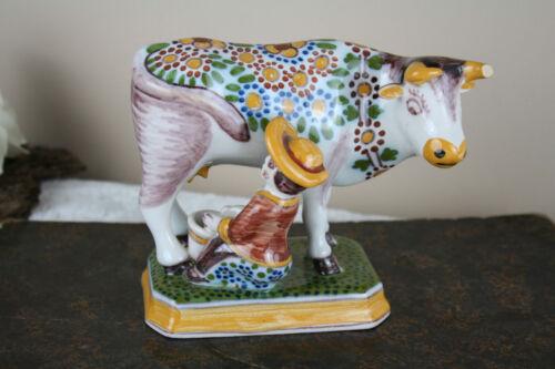Dutch polychrome Makkum tichelaar marked girl milking cow pottery figurine
