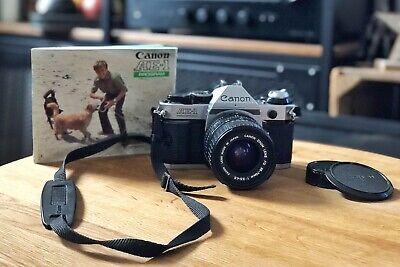 Canon AE-1 Program mit Canon FD 35-70mm und Bedienungsanleitung