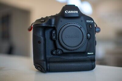 Canon EOS 1DX Mark II MarkII DSLR w box & access. 560 act. only! MINT USA!