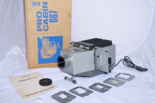 Linhof  Pro Cabin 667 35mm to 6x7cm medium format projector.  (6) slide holders.