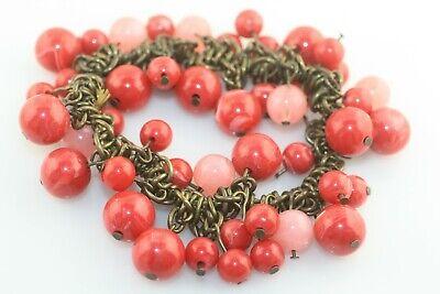 - Antiqued gold tone dangle bold bead pink red swirl plastic stretch bracelet