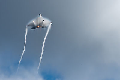 Unique Photo- An F-22 Raptor Aerial Maneuvers  in support of the Arctic Thunder