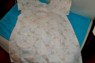 Robe  dior 2 ans les hirondelles roses petites poches noeuds
