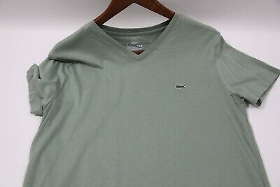 #911  Lacoste V-Neck T-Shirt Size 4  small