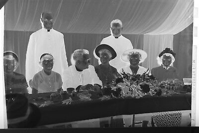 (1) B&W Press Photo Negative Couple Banquet Table Men Dress Coats Standing T2180