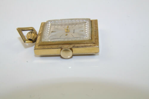 Vintage Ladies Gold Tone Pendant Watch by Vantage Working