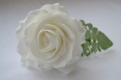 Ivory or white vintage antique rose wedding buttonholes groom best man guests