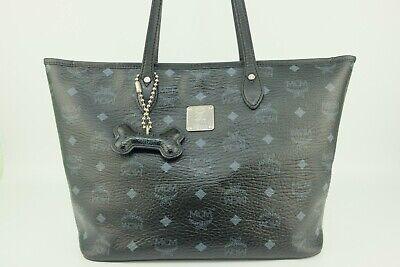 100% Authentic MCM Black Visetos Medium Shopper Shoulder Bag With Bone Charm