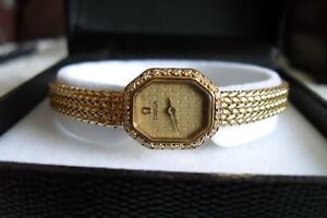 18ct GOLD OMEGA WATCH WITH 18CT GOLD BRACELET STRAP & 28 SMALL DIAMONDS.
