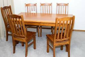 Dining table with 6 matching chairs up for sale