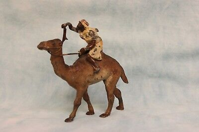 """4"""" Tall 4-1/2"""" long Lead camel with bearded Arab rider, cold painted circa 1900"""