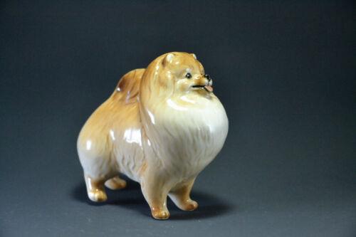 Statuette made of porcelain dog Pomeranian Spitz