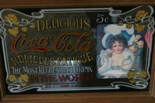 A collection of 4 Vintage Coca Cola Advertisement Mirror and Frames.