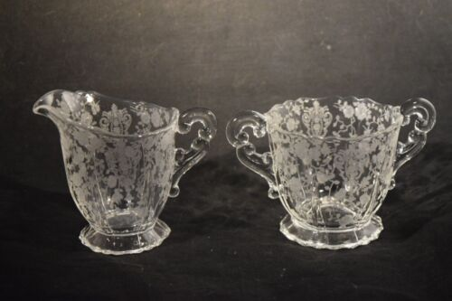 Vintage  pressed glass creamer and sugar bowl , etched flowers scrolled handles