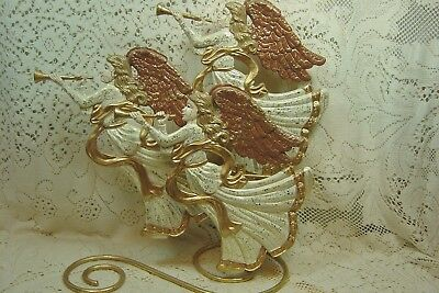 GOLD TRIMMED ORNATE ANGEL TRIO BLOWING HORNS ON SWIRLED METAL BASE ROMAN INC.