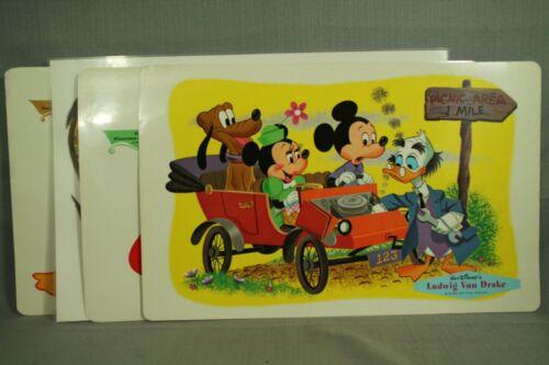 set 4 diff vintage Walt Disney vinyl placemats Ludwig Von drake Mickey Mouse etc