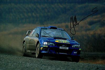 Juha KANKKUNEN RALLY WRC DRIVER SIGNED AUTOGRAPH 12x8 Subaru Photo AFTAL COA
