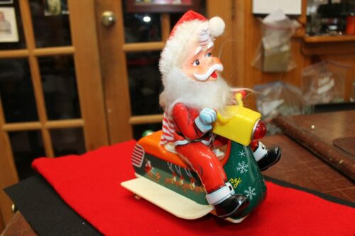 VINTAGE MODERN TOYS BATTERY OPERATED TIN SANTA ON A SCOOTER EXCELLENT NO BOX