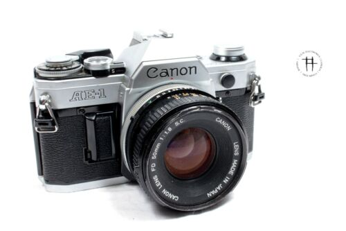 Canon AE-1 35mm film SLR camera w/50mm f/1.8 lens, broken for parts/repairs