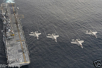 U.S. NAVY-Four F-35B Lightning II aircraft Flyover Assault Ship USS America