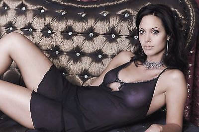 Angelina Jolie Posing On The Couch 8X10 Picture Celebrity Print