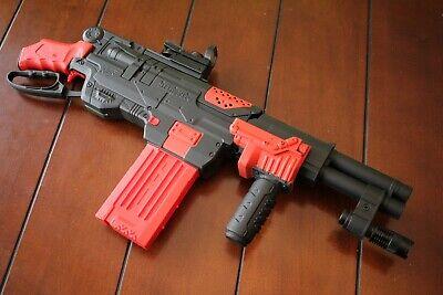 Modded Nerf Slingfire, reflex sight, modded grips, flashlight and more