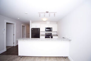 Spacious 2+Den in Russell Lake! Rooftop Patio + Fitness Centre!