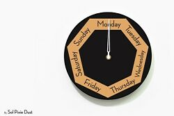 DayClocks - Hexagon Black & Orange Wall Clock - Day of The Week Clock