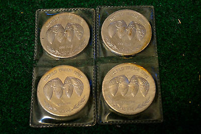 (4) 1974 World Trade Unit Silver Coins / 999 Fine / Pure Silver / One Troy Ounce