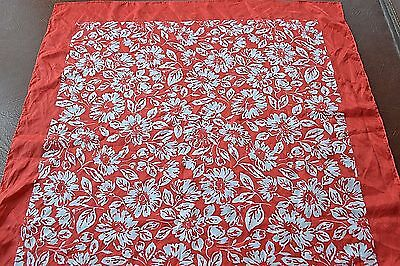 large polyester scarf red background with white floral design