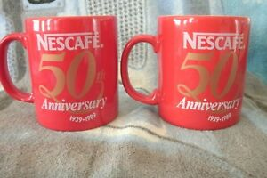 2 NESCAFE 50th Anniversary Coffee Mugs  . FREE UK P+P ..........................